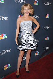 Izavella wears a strapless dress with circle embellishments to 'The Cape' premiere in Hollywood.