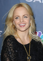 Mena Suvari attended the premiere of NBC's new television show 'The Cape' wearing Albert spiked earrings.