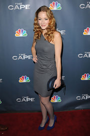 Jennifer Ferrin added a glam touch to her red carpet look with a blue crescent shaped clutch.