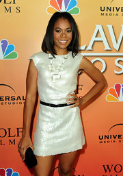 Regina Hall shimmered on the red carpet in a sequin-clad dress, complete with a waist cinching belt.