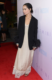 Zoe Kravitz topped off her dress with a black fur-cuff blazer by Prada.