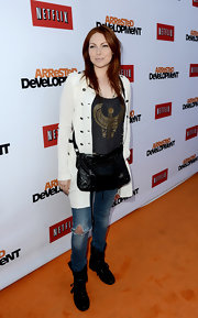 Laura Prepon rocked a pair of ripped jeans at the 'Arrested Development' premiere in Hollywood.