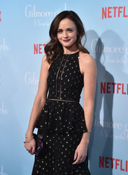 Alexis Bledel paired a purple Judith Leiber hard-case clutch with a polka-dot dress for the premiere of 'Gilmore Girls: A Year in the Life.'