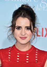 Laura Marano traded in her signature loose waves for this messy updo when she attended the premiere of 'Gilmore Girls: A Year in the Life.'