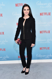 Vanessa Marano punctuated her black look with a colorful printed clutch.