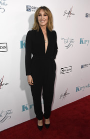 Felicity Huffman chose a long-sleeve black jumpsuit with a deep-V neckline for the premiere of 'Krystal.'
