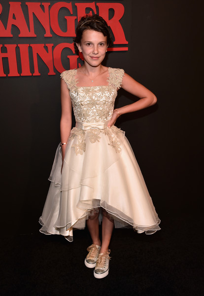 More Pics of Millie Bobby Brown Messy Cut (1 of 5) - Short Hairstyles Lookbook - StyleBistro [stranger things,dress,clothing,cocktail dress,white,fashion model,fashion,shoulder,lady,beauty,gown,arrivals,illie brown,california,los angeles,netflix,mack sennett studios,premiere]