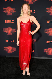 Maika Monroe oozed glamour wearing this red sequin slip dress by Stella McCartney at the premiere of 'Stranger Things' season 2.