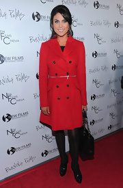Nadia looks fire hot in winter in a red wool coat with a midway zipper.