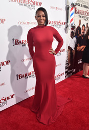 Melanie Brown cut a curvy silhouette in this red fishtail gown at the premiere of 'Barbershop: The Next Cut.'