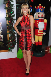 Mena attended the premiere of 'A Very Harold & Kumar 3D Christmas' in a fiery red backless print dress.