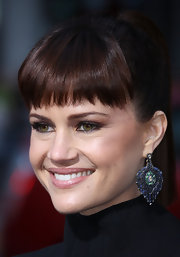 Actress Carla Gugino framed her face with her edgy blunt cut bangs. She kept things super slick by donning a high ponytial.