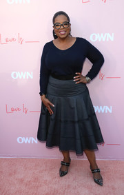Oprah Winfrey opted for a simple and comfy navy scoopneck sweater when she attended the premiere of 'Love Is _.'
