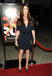 Paz dons a wide black belt with a large bow over her navy dress for the premiere of 'Cat Run.'