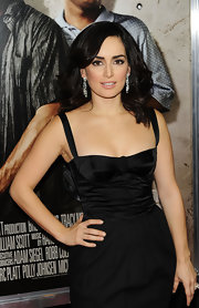 Ana keeps it sexy and simple, accessorizing her corseted LBD with diamond dangle earrings.