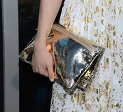 Leah Gibson paired an oversized, metallic gold foldover clutch with her gold frock for a super-shiny red carpet look.