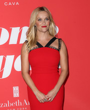 Reese Witherspoon kept the sparkle to a minimum when she attended the premiere of 'Home Again,' wearing only a simple diamond bracelet and some rings.