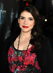 Stephenie Meyer chose a retro-glam red carpet look with long, shiny curls pinned back slightly.