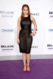 Debby Ryan paired her dress with elegant red ankle-tie pumps by Bionda Castana.