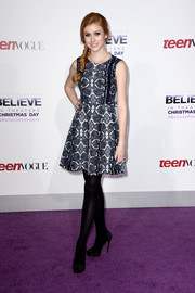 Katherine McNamara stepped out on the purple carpet looking chic in a fit-and-flare print dress during the premiere of 'Justin Bieber's Believe.'