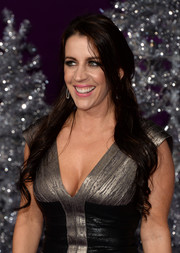 Pattie Mallette looked ravishing with her wavy half-up 'do teamed with a low-cut bandage dress at the premiere of 'Justin Bieber's Believe.'
