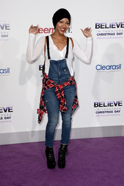 Meagan Good completed her casual outfit with a pair of chunky black lace-up boots.