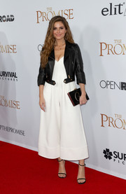 Maria Menounos' black leather jacket worked chicly with her white jumpsuit!