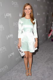 Ahna O'Reilly polished off her sophisticated ensemble with a floral-beaded white clutch by Dior.