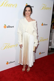 Aubrey Plaza layered a slouchy V-neck sweater over a two-tone dress, both by 3.1 Phillip Lim, for the premiere of 'Flower.