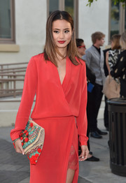 Jamie Chung looked perfectly put together with this beaded clutch and red wrap dress combo at the 'Resident Advisors' premiere.