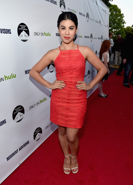 Chrissie Fit looked summery in a red spaghetti-strap mini dress during the premiere of 'Resident Advisors.'