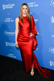 Alicia Silverstone channeled her inner diva in a one-sleeve red fishtail gown by Christian Siriano at the premiere of 'American Woman.'