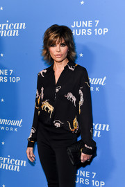 Lisa Rinna arrived for the premiere of 'American Woman' carrying a quilted black clutch by Gucci.