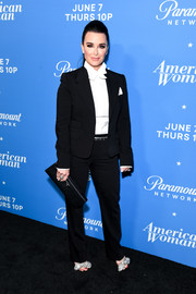 Kyle Richards completed her ensemble with a black leather clutch.