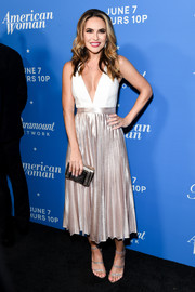 Chrishell Stause cut a chic figure in a two-tone cocktail dress with a plunging neckline and a pleated skirt at the premiere of 'American Woman.'