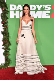 Alessandra Ambrosio looked darling in a flower-appliqued empire-waist gown by Carolina Herrera at the premiere of 'Daddy's Home 2.'