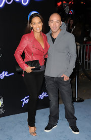 Tia Carrere attended the premiere of 'Footloose' carrying a long black leather clutch.