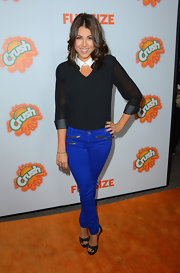 Daniella Monet attended the 'Fun Size' premiere wearing a pair of studded platform sandals.