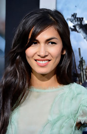 Elodie Yung's red carpet look was soft and feminine, especially with this long wavy style styled with long side bangs.