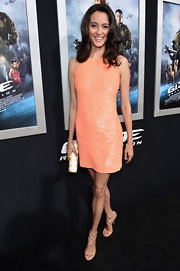 Emma Hemin chose a sparkly cocktail dress in a fun peach color for her red carpet look at the 'G.I. Joe: Retaliation' premiere.