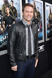 Scott Porter appropriately chose a black zip-up leather jacket for his red carpet look at the 'G.I. Joe Retaliation' premiere in Hollywood.