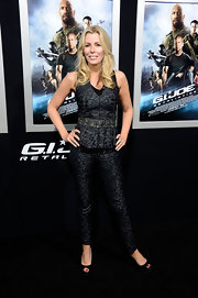 Aviva Drescher played matchy-matchy with this gray peplum top and matching pants.