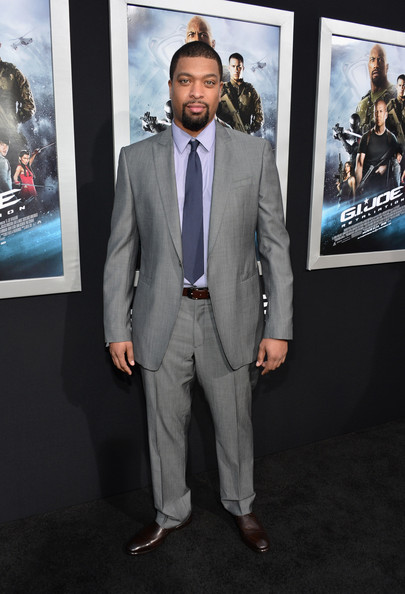 DeRay Davis chose a classic gray suit to pair over a soft lavender button up for his red carpet look.