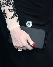 Molly Ringwald chose a basic black satin clutch to top off her red carpet look at the 'G.I. Joe: Retaliation' premiere.