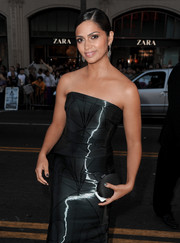 Camila Alves paired an oval-shaped black satin clutch with a shiny strapless gown for the 'Interstellar' premiere.