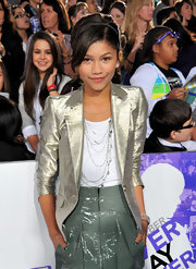 Zendaya layered up on her silver necklaces for the 'Justin Bieber' movie premiere.