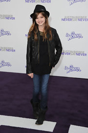Ciara Bravo was edgy-chic at the 'Justin Bieber: Never Say Never' premiere in a ruffled black leather jacket, tiered blouse, jeans, and combat boots.