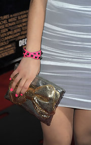 Ariana brought her bright pink polish to life with a leather studded bracelet.