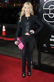 Jenna channeled Barbie with a hot pink clutch.