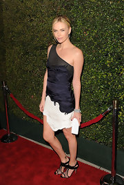 Charlize Theron donned a one-shoulder dress with a mesh strap for the 'Young Adult' premiere.